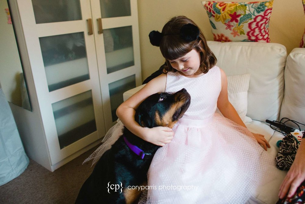 Flower girl and the puppy! I love the way they are looking at each other. So cute.