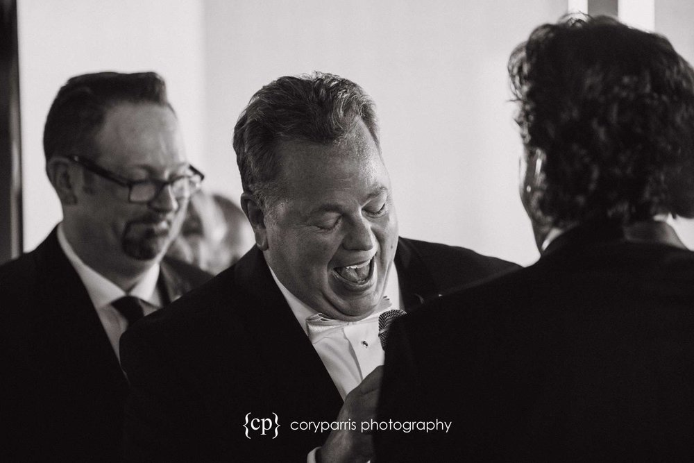 Groom laughing during Columbia Tower Club ceremony