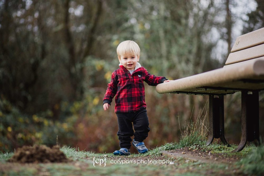 Little boy walking along a bench portrait photography