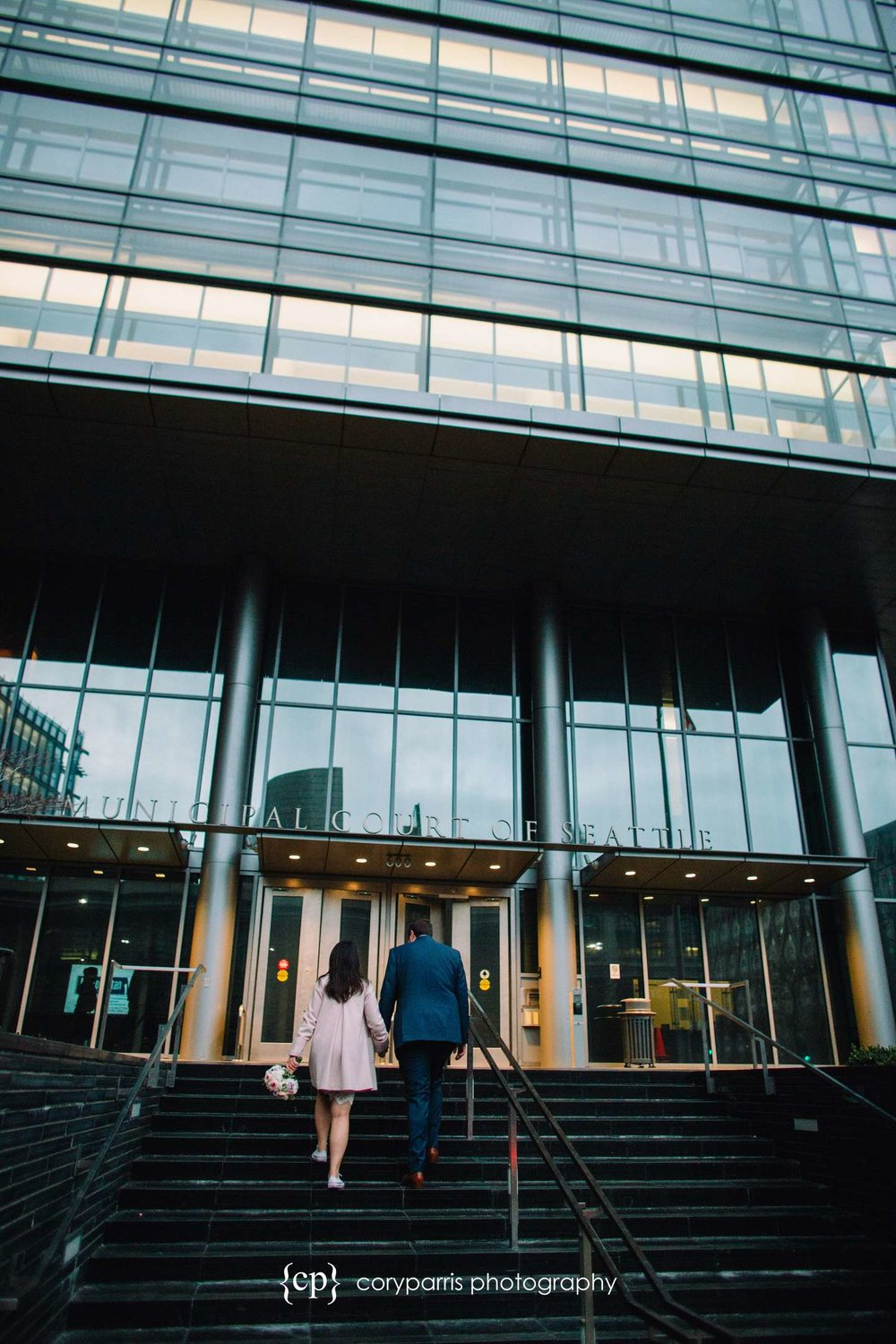 Wendy and Chris walking into the front of the Seattle Municipal Courthouse.