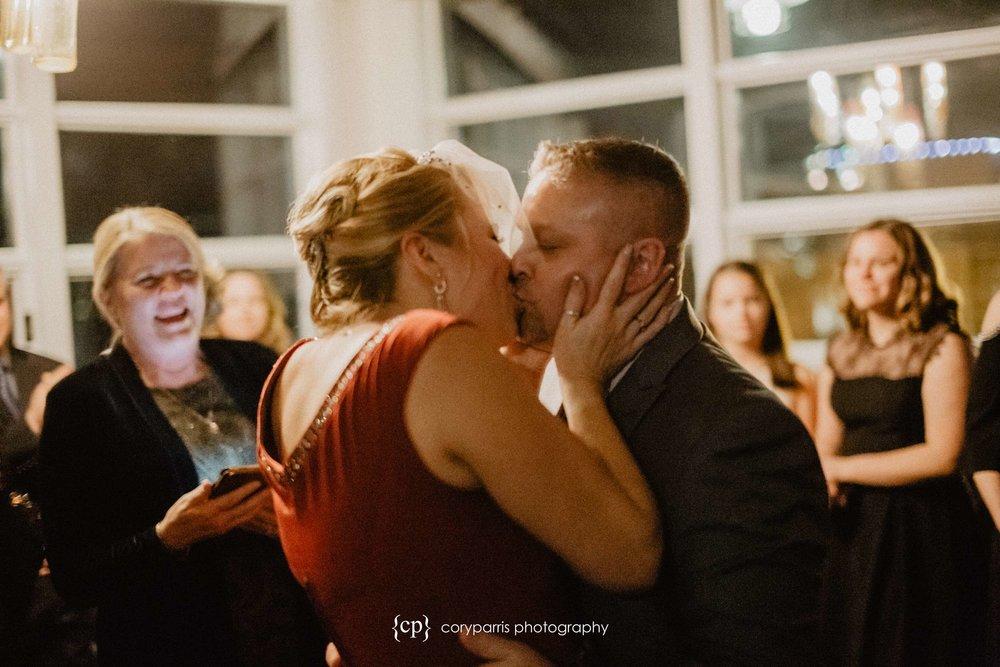 First kiss at a Seattle wedding photographer