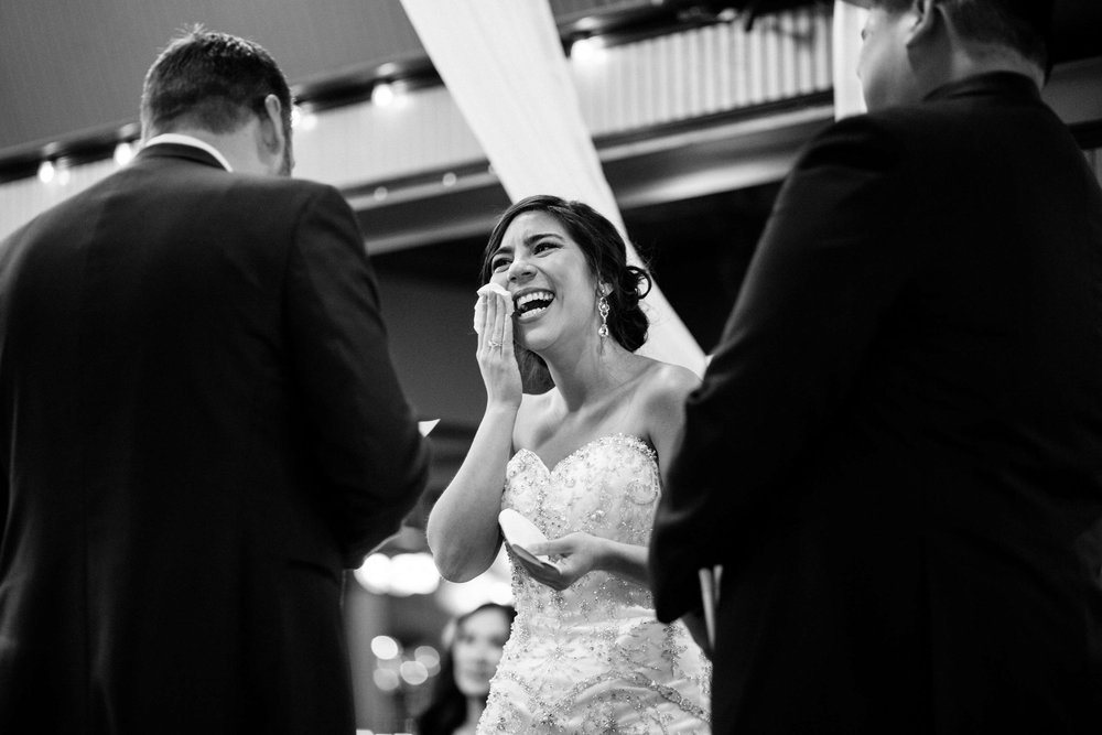 This bride is crying during the wedding. This is an example of pure wedding photojournalism as there was, obviously, no setup.