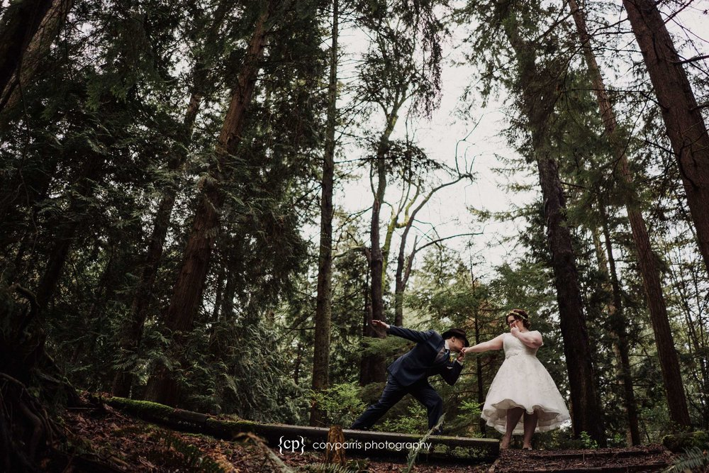 Caytlin and Ryan being fun during their wedding portraits at Forest Park in Everett.