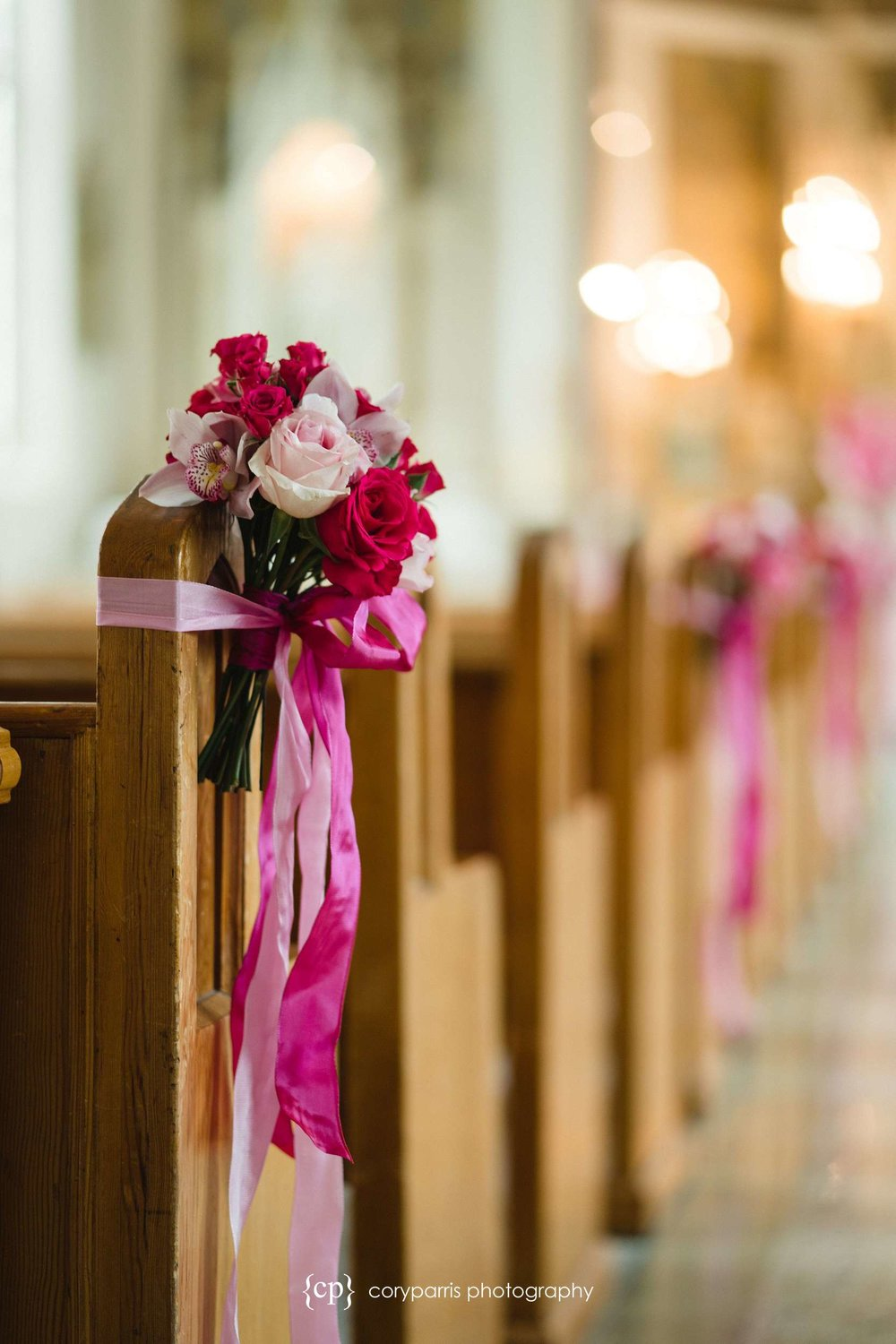 pink flowers on pews seattle wedding