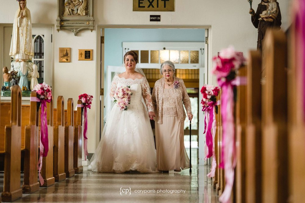 Bride and mom walking down the aisle at villa academy