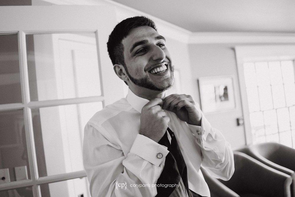 Payam tying his tie.