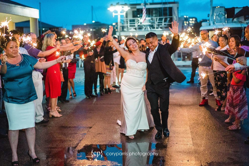 Angela & Poy's sparkler exit after their Seattle Courthouse wedding and their reception at Daniels Broiler