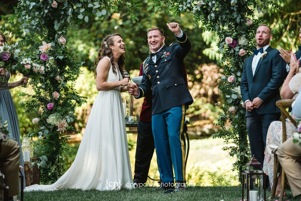 Pamela and Luke during their wedding ceremony at DeLille Cellars in Woodinville. I love how happy they are!