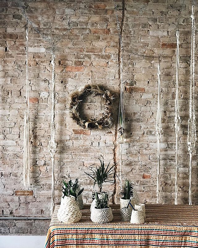 All the trimmings for our holiday market tomorrow. Come and discover some gorgeous gifts from local makers - seem here, one-of-a-kind pots from @ceramicsbygisela, macrame wall hangings (will come with plants) by @jo_macrame and wreaths by @whatscookingoodlooking_. We will also have gifts @7115nyc, @lxgeneralstore @summitstreetbk @brigadeironyc @globalgoods @noelani_cashmere. We will also have coffee by @terrakaffe and @whatscookingoodlooking_ @arthurstreetkitchen @b.e.weathers will be cooking up holiday treats. Stop by, info via link.