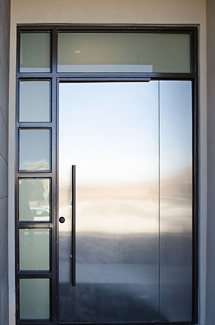 Modern pivot door with side light and transom.jpg
