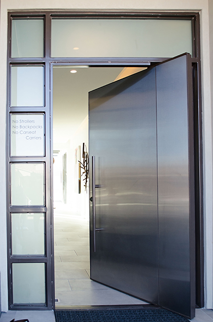 Modern pivot door with side light and transom open.jpg