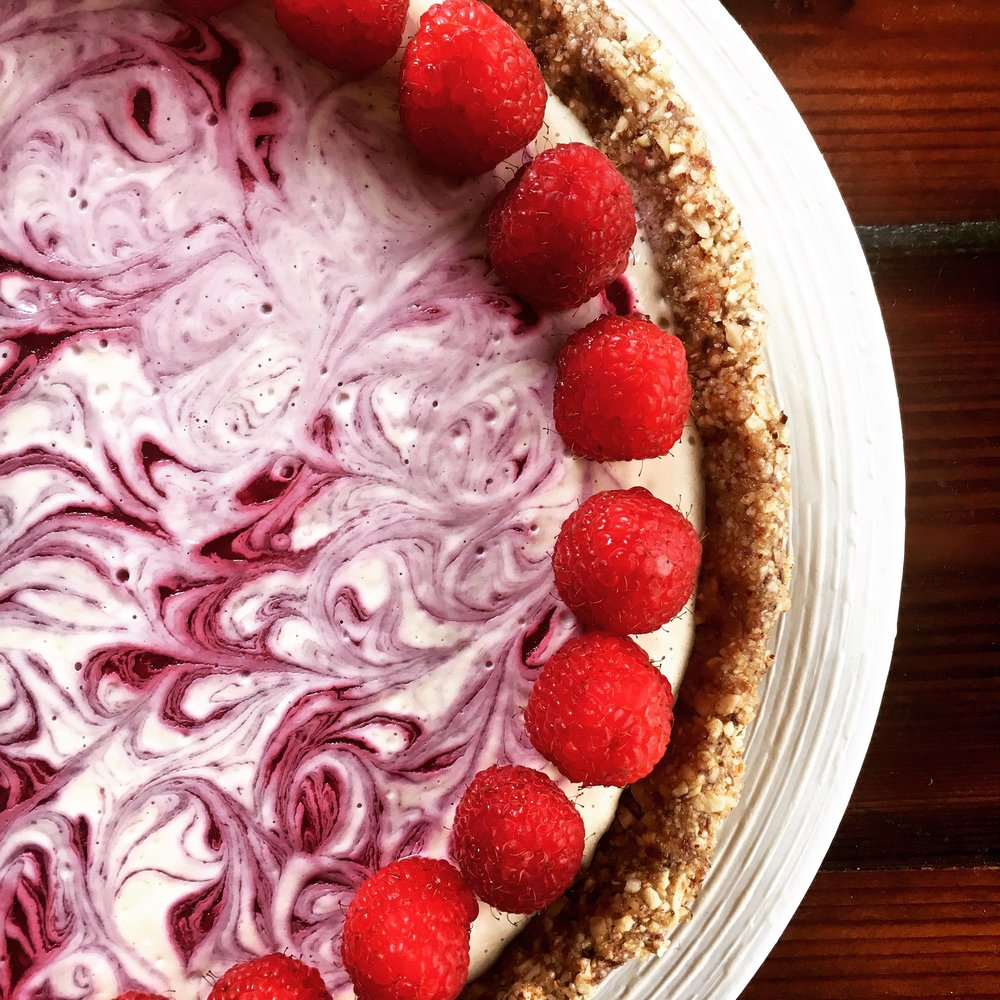 Raw lemon cream pie with a raspberry swirl