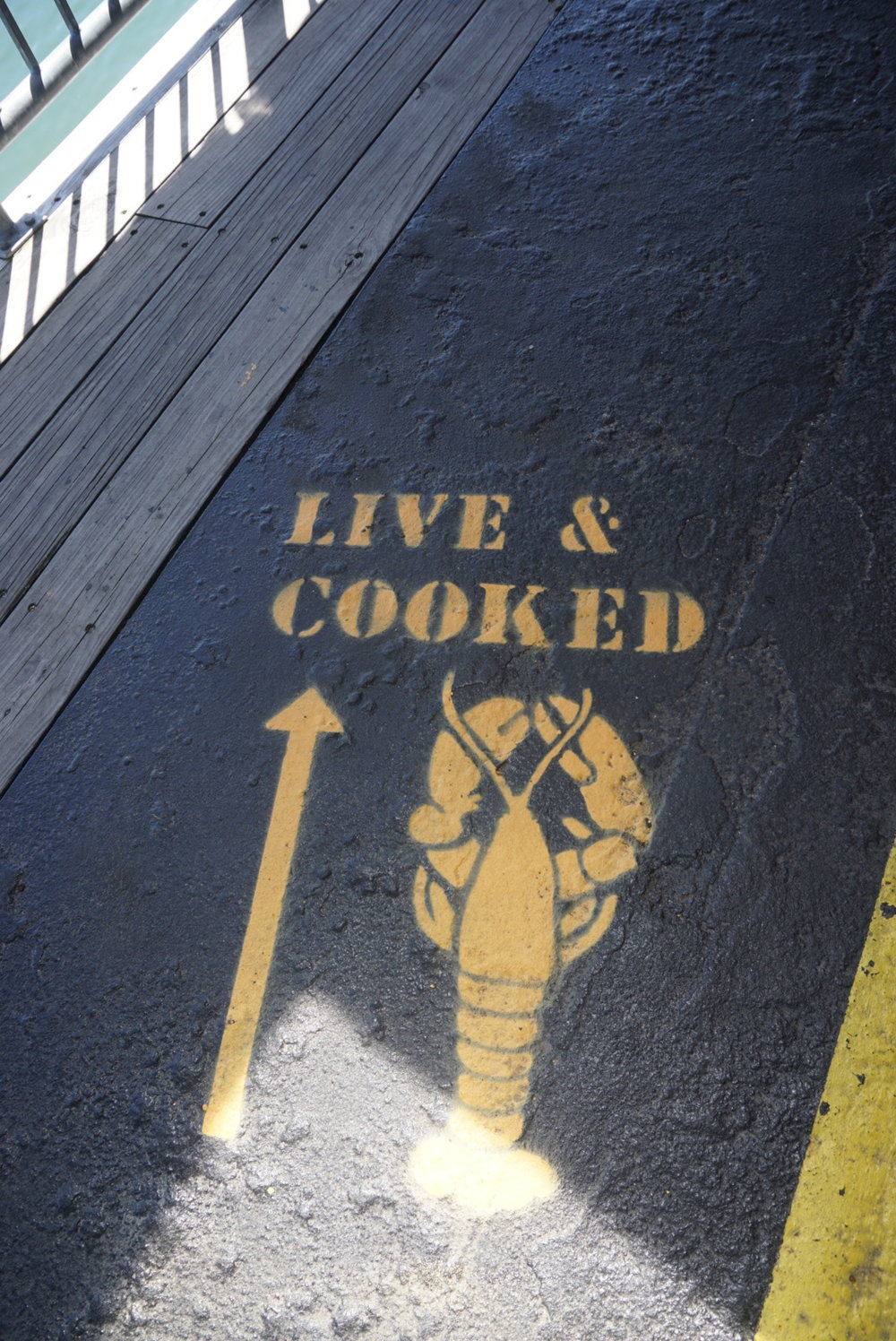 Follow the yellow-sprayed lobsters to find the lobster window!