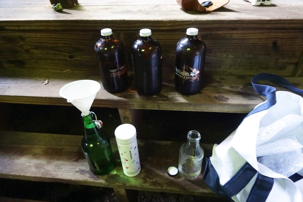 We brought a funnel with us to fill the smaller mouthed bottles. Insider tip: old beer growlers are great for filling with spring water! :)