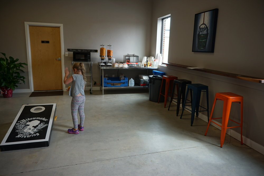 They have a number of games available, including board games, corn hole, and a ring/bell game. They also have a small snack station in the corner, but encourage visitors to order in or bring some grub with them-- loooove that option!