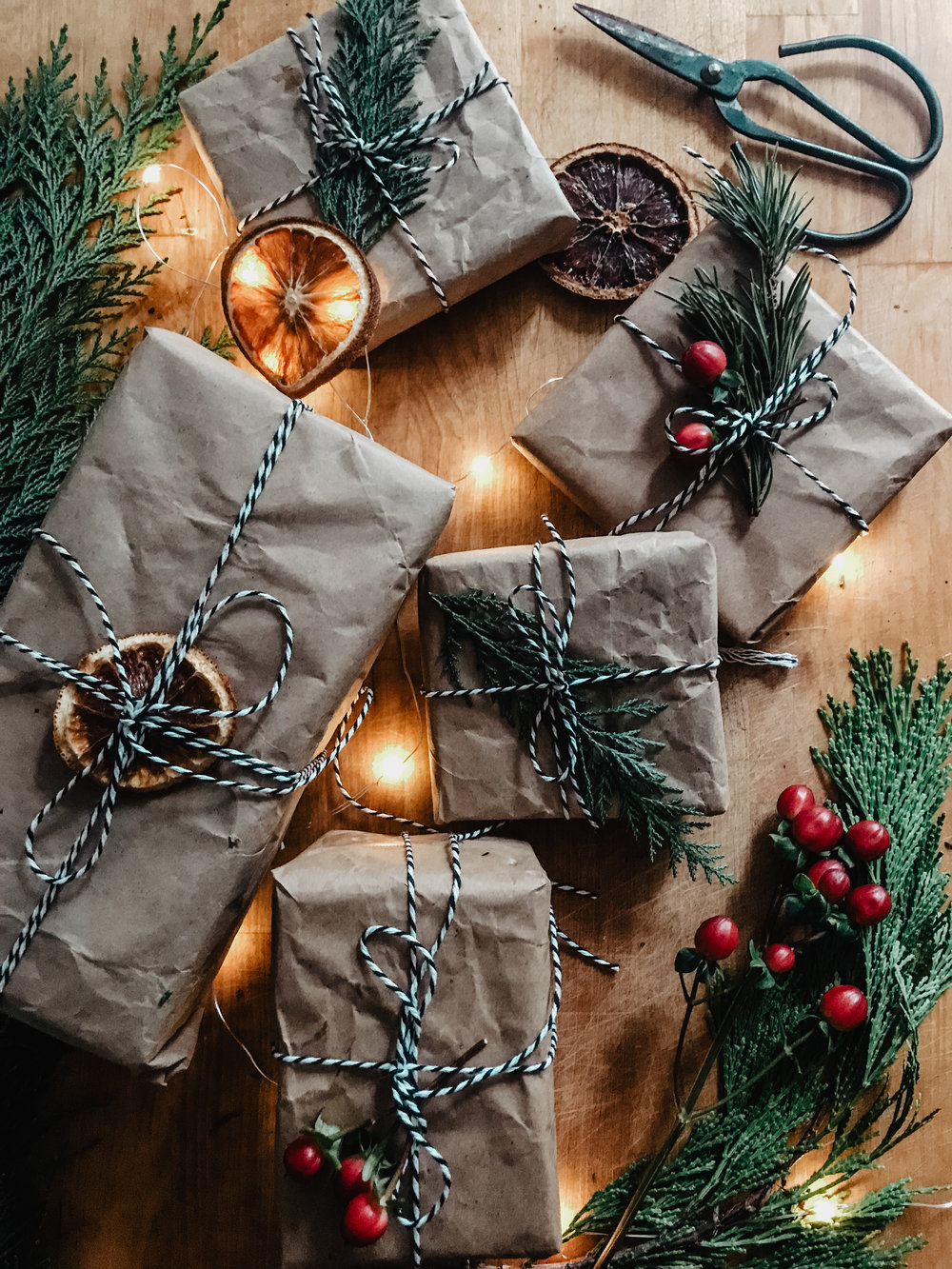 Instead of buying wrapping paper, I've been collecting any paper bags that I get. I love it because it is versatile, minimalist, and best of all, more sustainably conscious!
