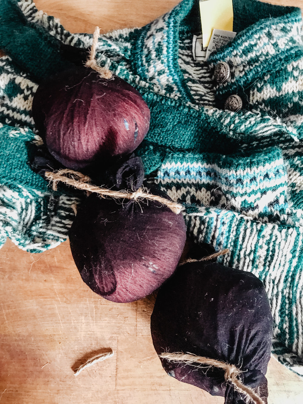 To felt the ball, put it in a pantyhose leg. Tie it off the ends with the piece of yarn. Wash the balls(s) with a load of laundry on HOT. Then dry them on the highest setting you have. Do this twice- or until the ball is completely felted.