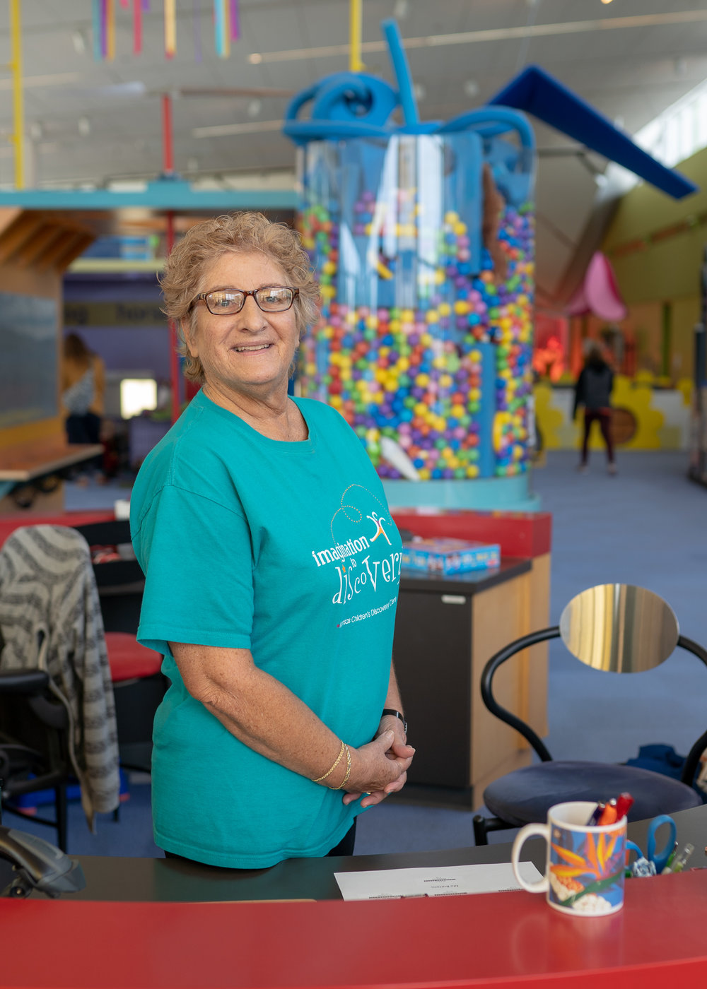 Topeka, Kansas—Molly Wisman volunteers at the front desk at the Kansas Children's Discovery Center. © James Gorman