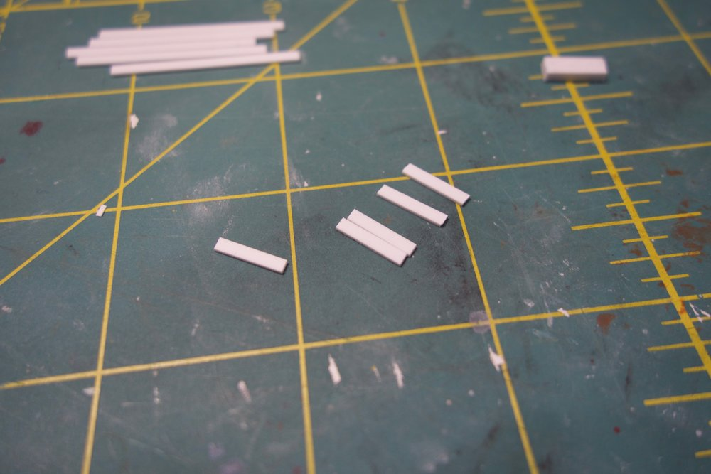 First, I cut many small styrene strips, which stack up to ~3.75mm (5x of .75mm thick strips).