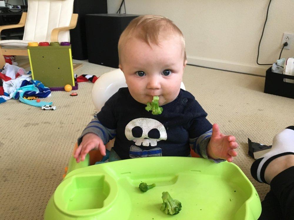 This kid loves broccoli