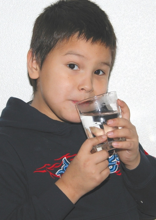 Blaze Neapetung First Nations Boy With Water Glass