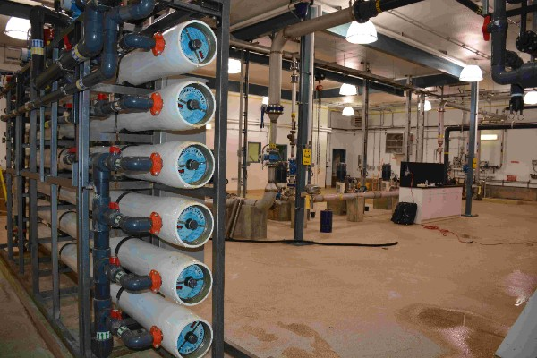 Reverse Osmosis Membranes used in the IBROM process. In the background there are distribution pumps and there is a lab bench in the water treatment plant.