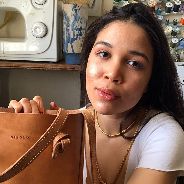 In my nisolo for my latest what's in my bag video ✌️ It's vegetable tanned preserved with no dye or artificial processes or chemicals. Untreated leather, from the outside it looks small ooh human stars it holds a lot! Ahaha not only my bag, but you get to see the all the random ones I carry. I've attached a podcast episode with the Nisolo crew by Conscious Chatter in my vid description. Listen in and discover the story behind Nisolo and why I L O V E the brand💗 #sustainable #fastfashion #inmynisolos #ecostyle #ethicalliving #whatsinmybag #plasticfree #sustainableoutfit #fairfashion #minimalistwardbrode #ethicallymade #ethicalfashion #sustainable #brillos #zerowaste #lessismore #fashionblogger #mindfulness #ethicalfashion #leather #upcycledclothing #whowhatwearing #stylish #reuse #highlighter #consciousfashion #inmyfeelings #trap