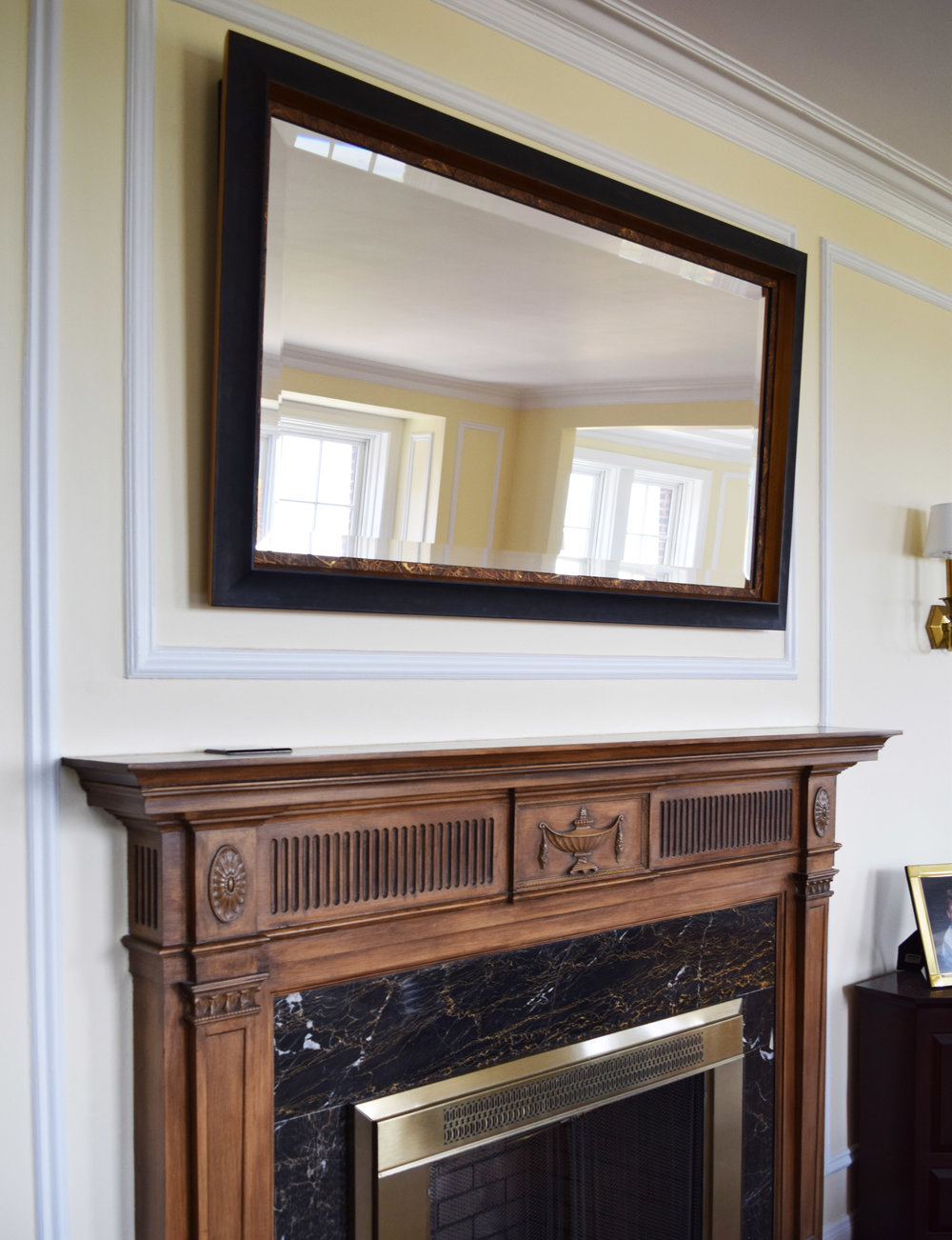 THE MIRROR IS INSTALLED AT AN ANGLE TO BRING THE BEAUTIFUL OUTSIDE IN