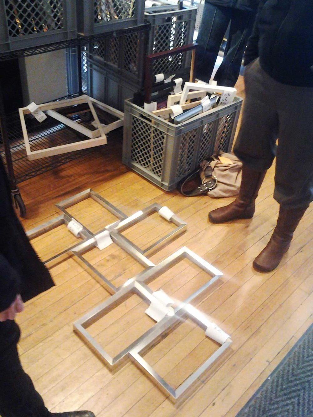 One of our framing consultants helping a customer lay out frames in the perfect design.