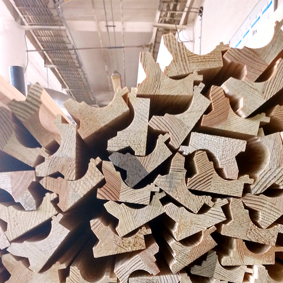 These mouldings have been carved and are ready to be hand finished in a variety of colors and materials. You can see the variation in the wood and how they've been fused together. It's a truly amazing process!