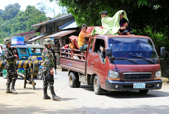 Duterte threatens harsh measures as thousands flee Philippines unrest - See perspectives on this story