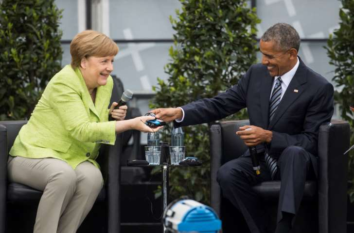 Obama gets rock-star welcome in Berlin, praises Merkel - See perspective on this story