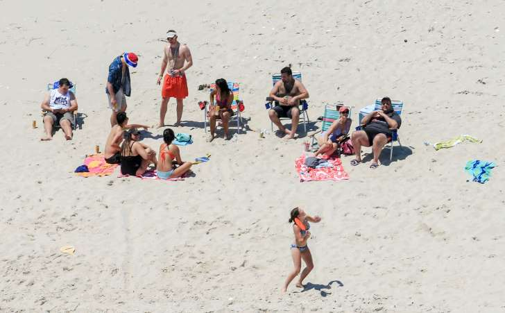 Christie defends use of beach closed to public amid shutdown - See the prespectives on this story