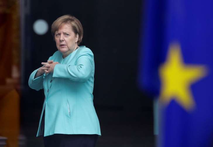 Merkel stands by suggestion Europe can't rely fully on U.S. - See perspectives on this story