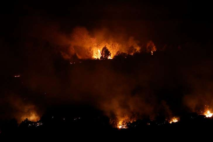Thousands evacuated central California, wildfires burn across U.S. West - See perspectives on this story