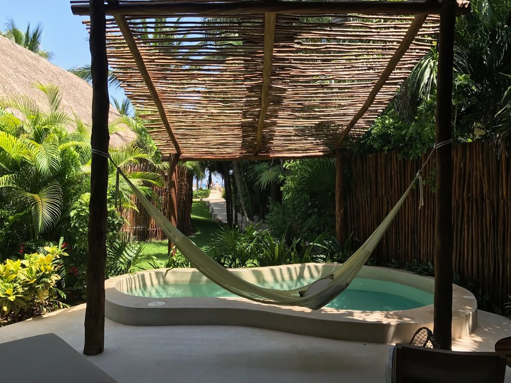 Every villa has its own plunge pool and hammock.