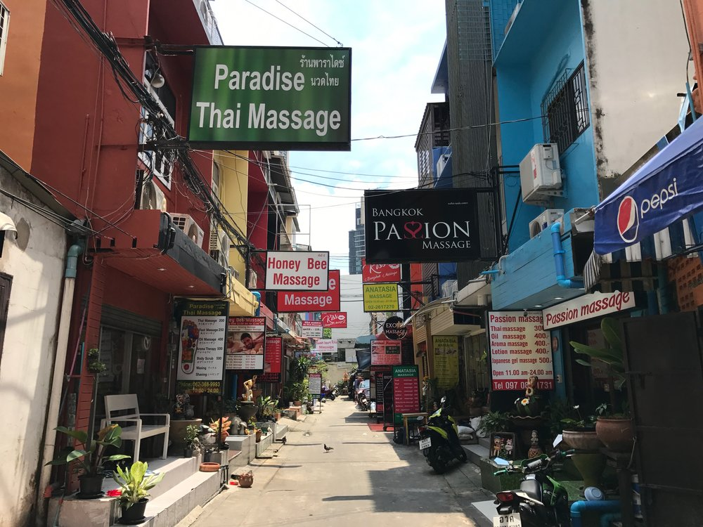 A typical alleyway chockfull of Thai massage places.