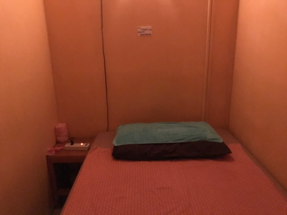 A typical treatment room in a Thai massage place off the street. It ain't the Four Seasons but for $8 a massage, it's worth it.