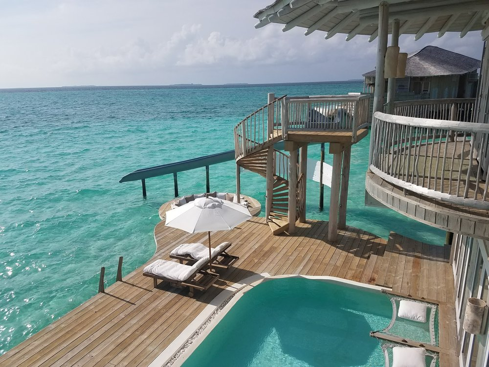 Overwater villas at Soneva Javi come equipped with their own water slide.