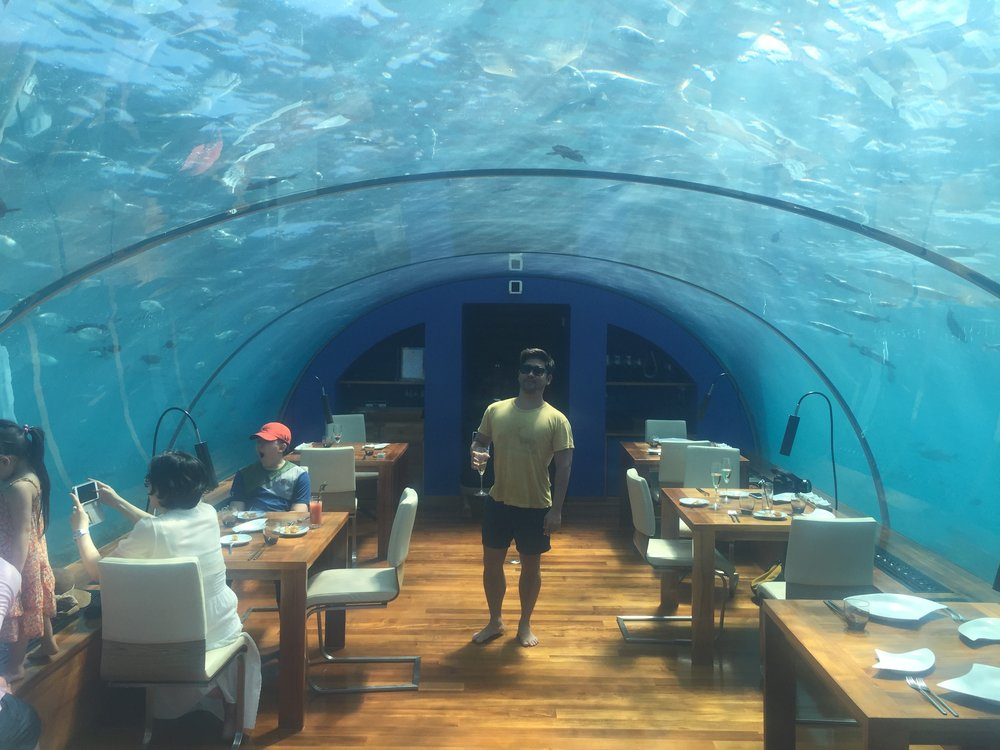 Having a drink in the world's first underwater restaurant in Maldives.