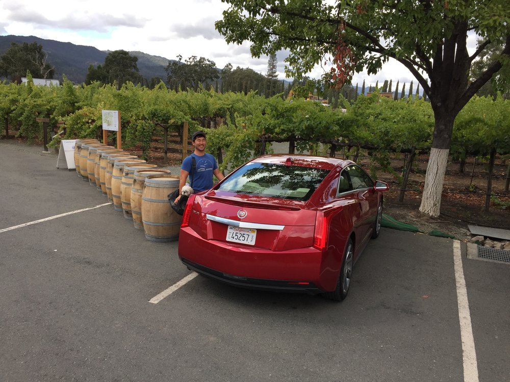 Do you think I can fit all these barrels of red wine into my car??