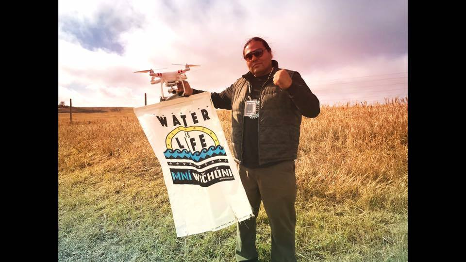 MYRON DEWEY Myron Dewey drone footage made him on of the most important journalistic voices to come out of the Standing Rock Movement.  Founder and owner of Digital Smoke Signals, Dewey is Newe-Numah/Paiute-Shoshone from the Walker River Paiute Tribe, Agui Diccutta Band (Trout Eaters) and Temoke Shoshone.  He is a Professor, filmmaker/editor, digital storyteller, historical trauma trainer, drone operator and journalist. Digital Smoke-Signals goal is to help bridge the digital divide throughout Indian Country and indigenize media through indigenous eyes with cultural core values ( Culture, Reciprpocity, Respect, and Family).