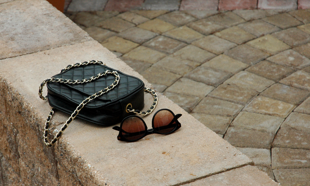 quilted bag and sunglasses