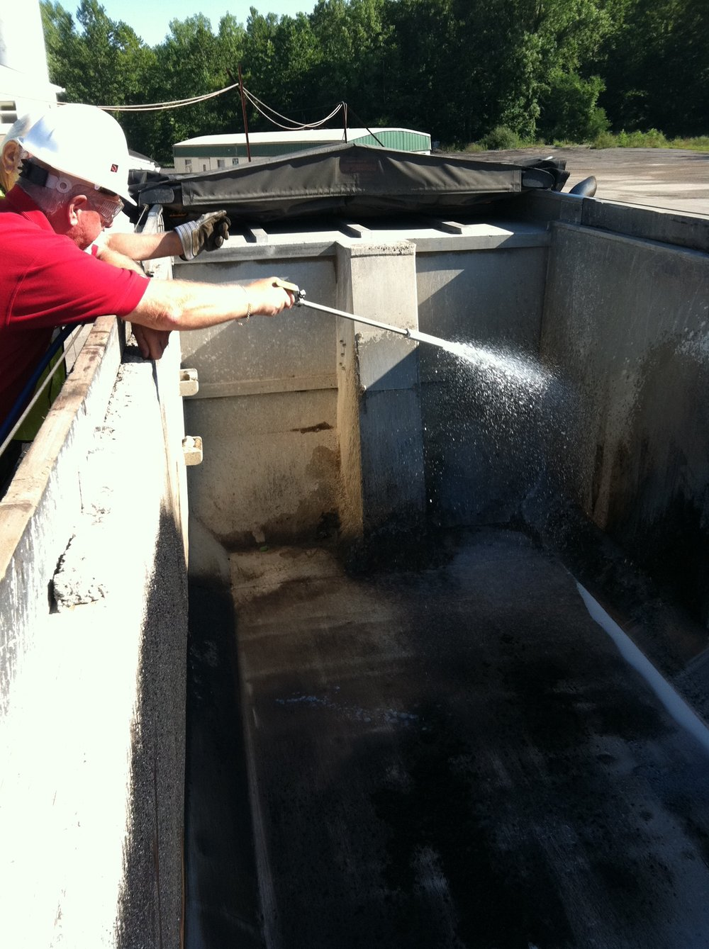 Asphalt Release Truck Bed Spray Application.JPG