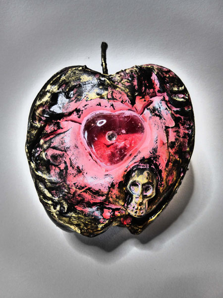 """Apple"", said the devil,  with a teardrop in his eye,  he'd sell you his immortal soul,  but all you want is pie.  ephemera #219   verse:13  Mixed media collage, half a styrofoam apple, skull, heart, acrylic paint."