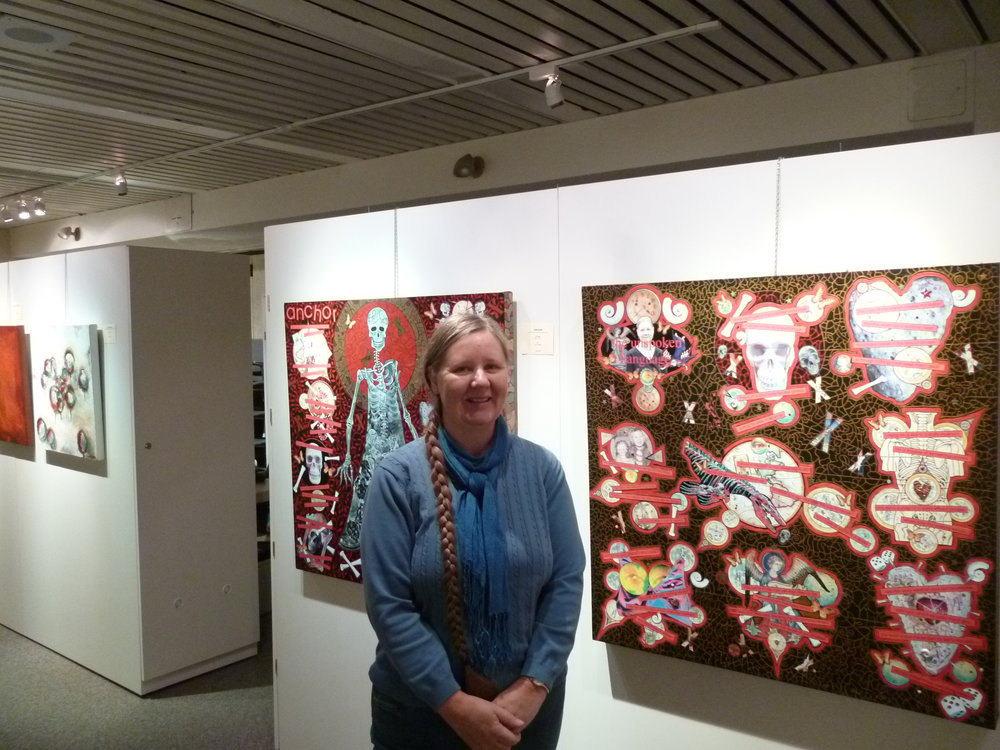 "Jo, in front of ""anchor"", and ""the unspoken language"".  Acrylic on canvas, mixed-media collage."