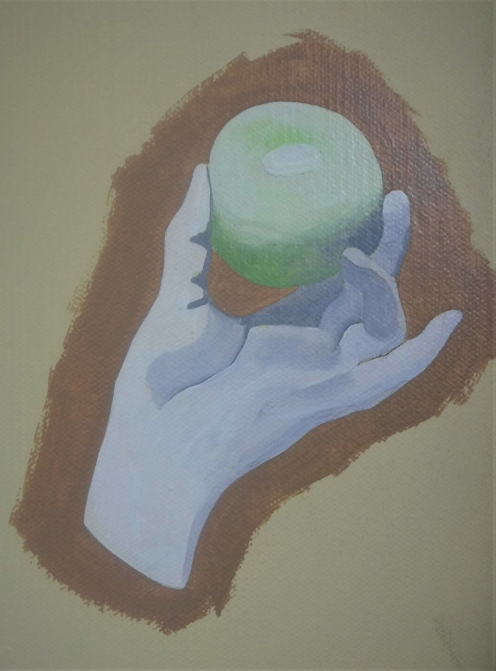 This is the first layer of paint on the left hand, holding the apple.