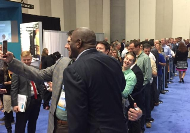 Hosting a Selfie Line with Keynote Speaker Magic Johnson will lead to lasting memories for your attendees