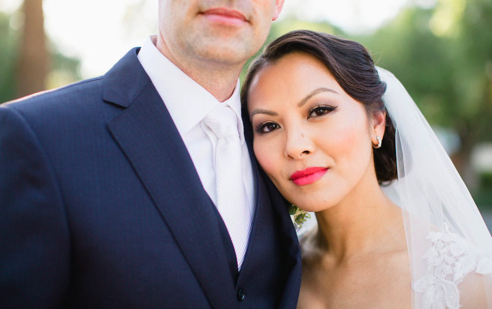 Asian Bridal Makeup with Eyeliner and Red Lipstick featuring an updo with veil. Wedding Hair and Makeup by Vanity Belle in Orange County (Costa Mesa) and San Diego (La Jolla)