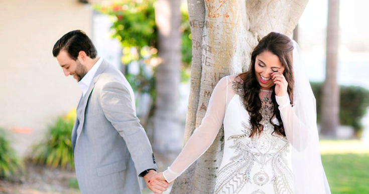 Wedding Photography with Couple Smiling Holding Hands Outdoors. Bridal Hair and Makeup by Vanity Belle in Orange County (Costa Mesa) and San Diego (La Jolla)